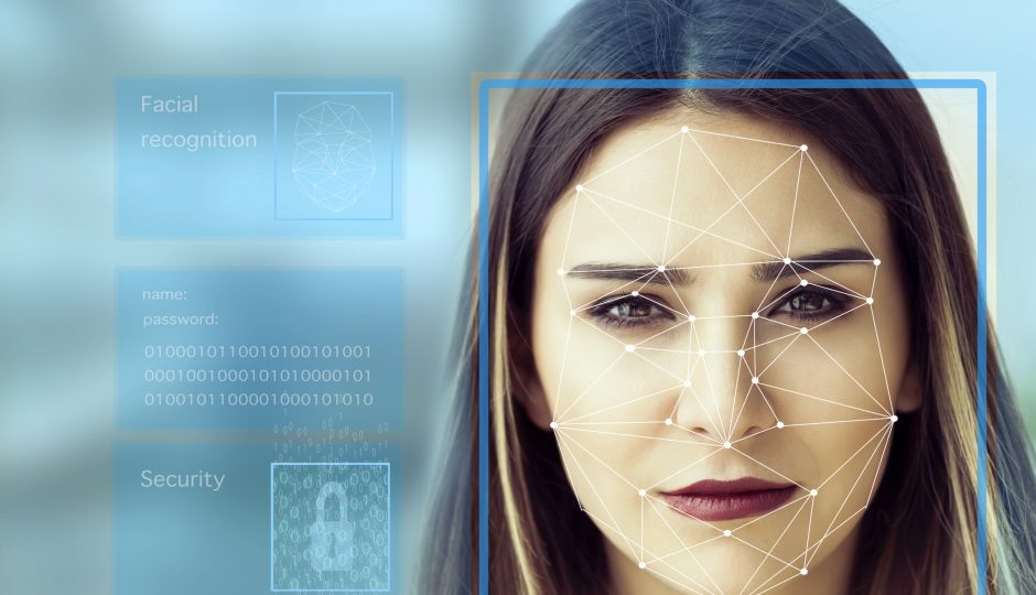 Woman with concept of facial recognition technology